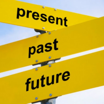 Photo of a sign post containing arrows pointing in different directions to the past, present, and future