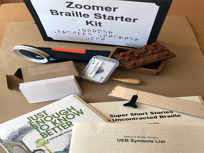 Photograph of all of the items in a complete Braille Zoomers Kit (described in more detail below)